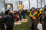 People walk around at Newroz, the Kurdish New Year celebration, in Diyarbakir, Turkey, March 21, 2015. Newroz, or Nowruz, is an ancient holiday celebrated by a multitude of ethnic groups across Iran, Central Asia, and the Caucuses, and ushers in the first day of Spring, March 21. For Kurds, Newroz is a means of political and cultural expression, featuring Kurdish politicians, activists, and musicians, and has become a manifestation of Kurdish identity. In Turkey, the celebrations begin a few days before the Vernal Equinox, culminating in a huge gathering in the heart of Turkey's Kurdish population, the southeastern city of Diyarbakir. This year, PKK founder Abdullah Öcalan, who despite serving a life sentence for treason still enjoys widespread influence among Kurds, sent a letter that was read at Newroz in Diyarbakir, calling for an end to the PKK's armed struggle against the Turkish state.