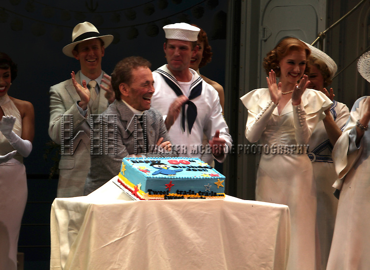 "Bernadette Peters surprises Joel Grey on his 80th birthday with a cake backstage at ""Anything Goes"" at the Stephen Sondheim Theatre in New York City on April 11, 2012 © Walter McBride / WM Photography  Ltd."