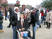 Spectators pose with a cardboard cutout of the new president as they brave the cold winter weather to attend the inauguration of US President Barack Obama, Tuesday, Jan. 20, 2009, in Washington, D.C. (Tricia Buchhorn/pressphotointl.com)