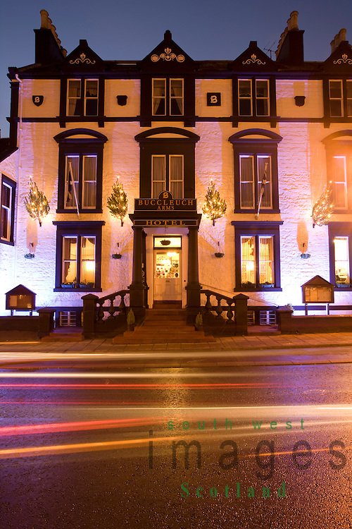 Seasonal Christmas lights on at night on the outside of the Buccleuch Arms Hotel on Moffat High Street Annandale Dumfries and Galloway Scotland UK