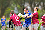 Spa Andrew Garnett feels the full force of Dromid's Micheal O Siochain during their Intermediate semi final in Killorglin on Saturday