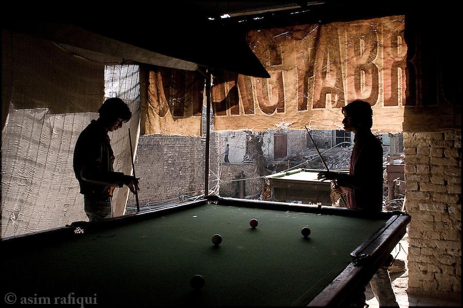 at a pool hall in a Karachi slum