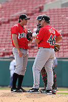 Indianapolis Indians pitching coach Tom Filer #46 talks with pitcher Bryan Morris #38 as catcher Eric Fryer #50 listens in during a game against the Buffalo Bisons at Coca-Cola Field on May 22, 2012 in Buffalo, New York.  Indianapolis defeated Buffalo 6-3.  (Mike Janes/Four Seam Images)