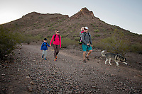 Jenny and Kurt Donnell hike with their daughter Mackenzie, 2 and Carter, 4, and dog Rio at Lookout Mountain in Central Phoenix.