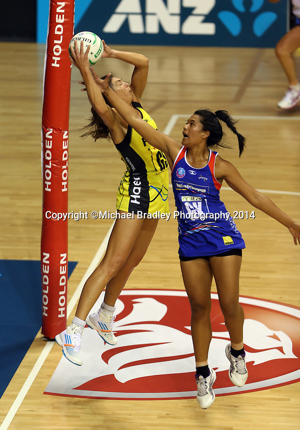 10.03.2014 Mystics Temalisi Fakahokotau and Pulse's Irene Van Dyk in action during the ANZ Champs match between the Northern Mystics and Hairer Pulse played at the Trusts Arena in Auckland. ©Michael Bradley.