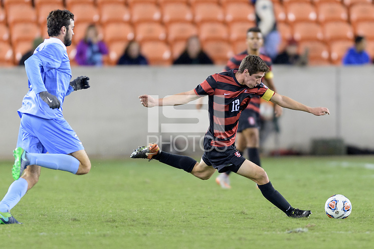 Houston, TX - Friday December 9, 2016: Drew Skundrich (12) of the Stanford Cardinal clears the ball against the North Carolina Tar Heels at the NCAA Men's Soccer Semifinals at BBVA Compass Stadium in Houston Texas.