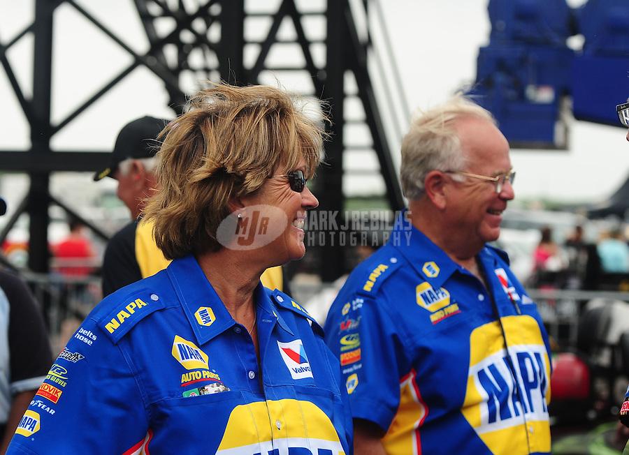 Apr. 30, 2011; Baytown, TX, USA: NHRA Tim Richards (right) and wife Kim Richards during qualifying for the Spring Nationals at Royal Purple Raceway. Mandatory Credit: Mark J. Rebilas-