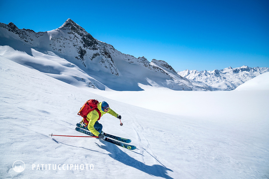 Skiing in the wide open landscape of the Rhone Glacier while on a ski tour of the Berner Haute Route, Switzerland