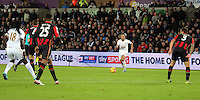 Neil Taylor of Swansea (C) prepares to cross the ball during the Barclays Premier League match between Swansea City and Bournemouth at the Liberty Stadium, Swansea on November 21 2015