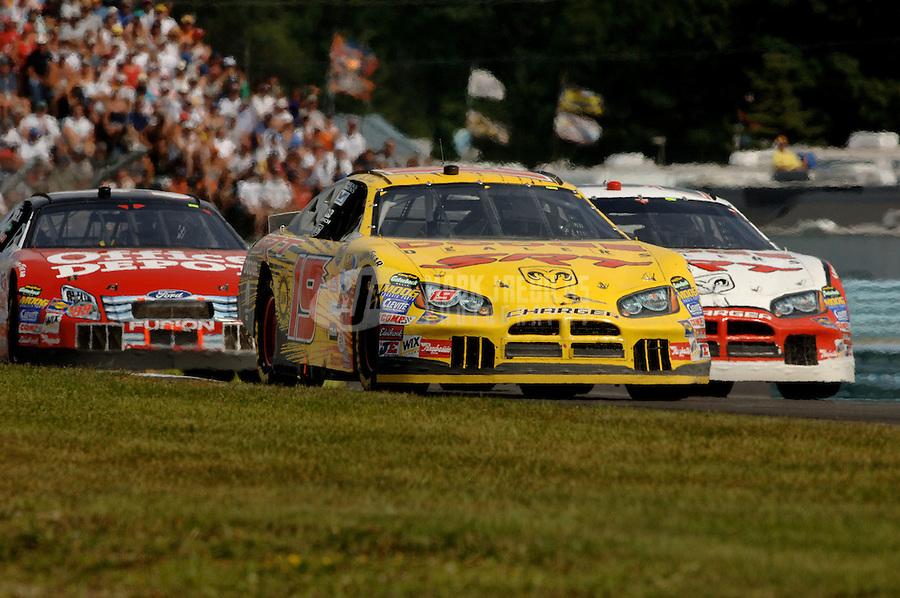 Aug. 13, 2006; Watkins Glen, NY, USA; Nascar Nextel Cup driver Bill Elliott (19) leads Kasey Kahne (9) and Carl Edwards (99) during the AMD at the Glen at Watkins Glen International. Mandatory Credit: Mark J. Rebilas