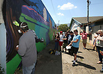 Mural artist Abner Rivera demonstrates his technique for a group of Boys & Girls Club members during a tour of local murals in Carson City, Nev., on Monday, July 31, 2017. Mark Salinas, Carson City's art and culture coordinator and the Adams Hub sponsored the tour. <br /> Photo by Cathleen Allison/Nevada Photo Source