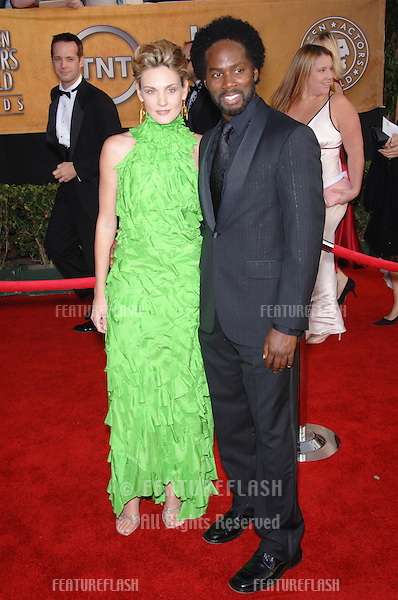 HAROLD PERRINEAU & wife BRITTANY PERRINEAU at the 12th Annual Screen Actors Guild Awards at the Shrine Auditorium, Los Angeles..January 29, 2006  Los Angeles, CA..© 2006 Paul Smith / Featureflash