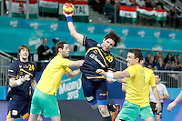 Spain's Antonio Garcia Robledo (c) and Australia's Ognjen Matic (l) and Martin Najdovski during 23rd Men's Handball World Championship preliminary round match.January 15,2013. (ALTERPHOTOS/Acero) /NortePhoto