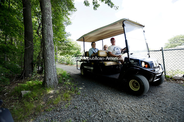 "Wolcott, CT- 10 July 2017-072617CM02- Volunteer John Kiely drives Don Kundee and Mary Graham of Wolcott  around the The Mill Pond Way walking trail along Scovill Reservoir on Wednesday.   For the second day, volunteers chauffeured residents who are unable to walk the 3.5-mile recreational trail on rides in motorized carts.  Mayor Thomas G. Dunn said he wants to make the trail accessible to as many people as possible. ""If they can't walk it, we want to make sure they see it,"" Dunn said.  Christopher Massa Republican-American"