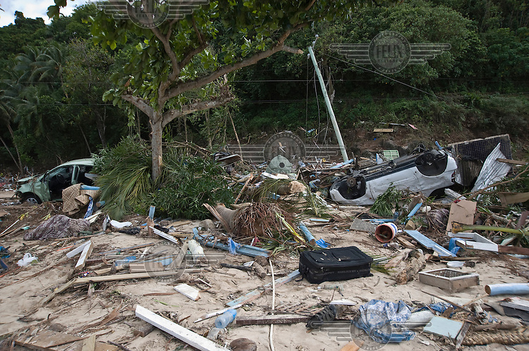 Debris strewn across the beach at Lalomanu. More than 170 people died when a tsunami triggered by an 8.3 magnitude earthquake hit Samoa and neighbouring Pacific islands on 29/09/2009. Samoa (formerly known as Western Samoa)..