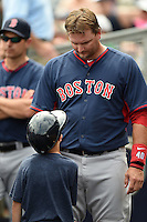Boston Red Sox catcher A.J. Pierzynski (40) talks with his son in the dugout during a spring training game against the Tampa Bay Rays on March 25, 2014 at Charlotte Sports Park in Port Charlotte, Florida.  Boston defeated Tampa Bay 4-2.  (Mike Janes/Four Seam Images)