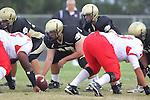 Palos Verdes, CA 09/30/11 - Arthur Fischer (Peninsula #67) and Ian Escutia (Peninsula #2) in action during the Lawndale-Peninsula Varsity football game.