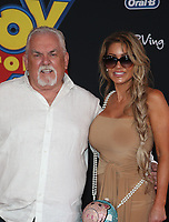 "HOLLYWOOD, CA - JUNE 11: John Ratzenberger, Julie Blichfeldt, at The Premiere Of Disney And Pixar's ""Toy Story 4"" at El Capitan theatre in Hollywood, California on June 11, 2019. <br /> CAP/MPIFS<br /> ©MPIFS/Capital Pictures"
