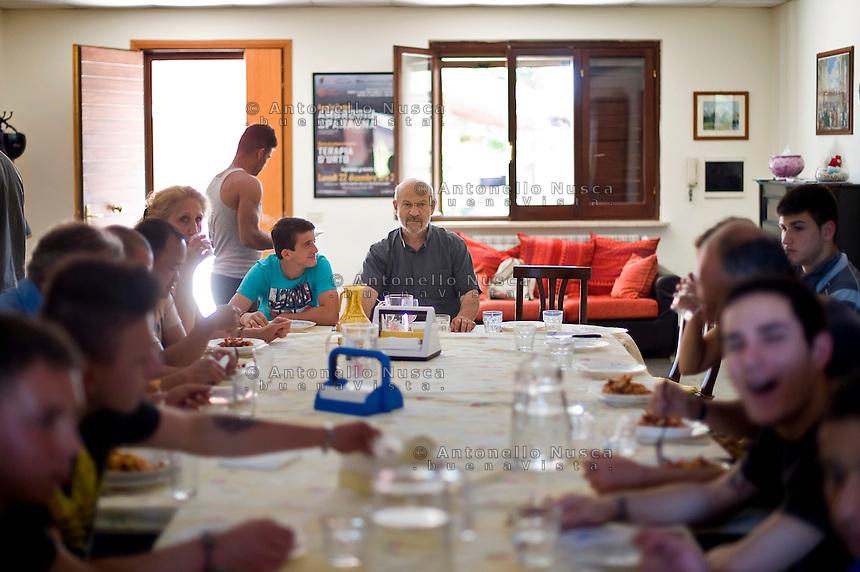 Roma, 13 Giugno, 2013. Padre Gaetano Greco, cappellano del carcere minorile di Casal del Marmo a Roma, durante il pranzo con i ragazzi ospiti del suo centro di recupero per minori.