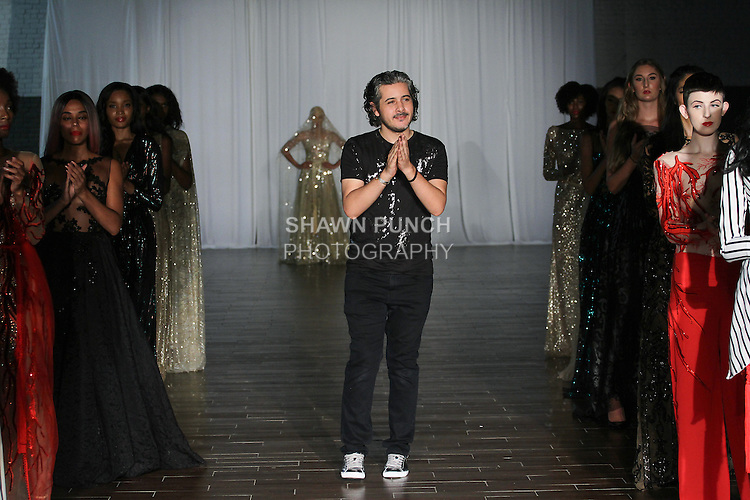 Fashion designer Kacem Sahl walks runway with models at the close of his Kacem Sahl Haute couture collection fashion show, for Fashion Week Brooklyn Spring Summer 2017, on October 8th 2016 at Brooklyn Expo Center.