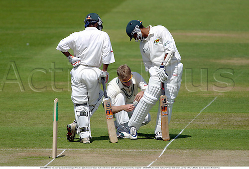 DION EBRAHIM has tape put over the straps of his leg pads to cover logos that contravene with advertising agreements, England v ZIMBABWE, First test match, NPower test series, Lord's, 030524. Photo: Steve Bardens/Action Plus...2003.Cricket .batsman batsmen.