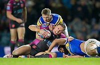 Picture by Allan McKenzie/SWpix.com - 08/02/2018 - Rugby League - Betfred Super League - Leeds Rhinos v Hull KR - Elland Road, Leeds, England - Hull KR's Shaun Lunt is tackled by Leeds's Brad Dwyer & Jamie Jones-Buchanan.