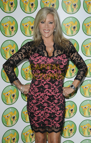 Samantha Fox.attended the Burgess Wetnose Awards, Jumeirah Carlton Tower Hotel, Knightsbridge, London, England, UK, 9th March 2012..half length  black dress pink lace hands on hips sam .CAP/CAN.©Can Nguyen/Capital Pictures.