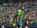 Seattle Sounders Clint Dempsey celebrates after scoring his second goal of the game against the Colorado Rapids during an MLS match on April 26, 2014 in Seattle, Washington.  Dempsey scored twice in the Seattle Sounders 4-1 win over the Colorado Rapids.  Jim Bryant Photo. ©2014. All Rights Reserved.