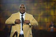 Canton, Ohio - August 1, 2014: Former NFL tackle Walter Jones dons his gold jacket during the Pro Football Hall of Fame's class of 2014 enshrinement dinner in Canton, Ohio  August 1, 2014. Jones was named to nine Pro Bowls during his career.  (Photo by Don Baxter/Media Images International)