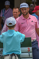 Jon Rahm (ESP) presents a ball to a young volunteer following  round 4 of The Players Championship, TPC Sawgrass, at Ponte Vedra, Florida, USA. 5/13/2018.<br /> Picture: Golffile | Ken Murray<br /> <br /> <br /> All photo usage must carry mandatory copyright credit (&copy; Golffile | Ken Murray)