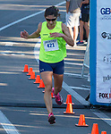 Ramona Sanchez was the first woman to cross the finish line (in 59:09) of the Reno 10 Mile Run in downtown Reno on Sunday, August 13, 2017.