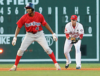 July 29, 2009: Casey Kelly (23) of the Greenville Drive, a top Boston Red Sox pitching prospect now playing shortstop, tries to fake T.J. Warren (4) of the Lakewood BlueClaws into thinking a pickoff attempt is being made in a game at Fluor Field at the West End in Greenville, S.C. Photo by: Tom Priddy/Four Seam Images