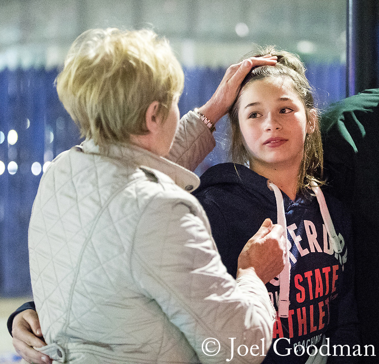 © Joel Goodman - 07973 332324 . 23/05/2017. Manchester, UK. A girl is brought to a police cordon from the Arena where she is greeted by relatives . Anxious parents wait by the police cordon for news of children inside the Manchester Arena . Police and other emergency services are seen near the Manchester Arena after reports of an explosion. Police have confirmed they are responding to an incident during an Ariana Grande concert at the venue. Photo credit : Joel Goodman