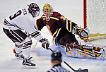 3 January 2009: Ferris State Bulldogs' goaltender Pat Nagle, a Sophomore from Bloomfield, MI, makes a save against forward Austin Smith, a Freshman from Dallas, TX of the Colgate Raiders during the consolation game of the 2009 Catamount Cup Ice Hockey Tournament hosted by the University of Vermont at Gutterson Fieldhouse in Burlington, Vermont. The two teams battled to a 3-3 draw, with the Bulldogs winning a post-game shootout 2-1, thus placing them third in the tournament...Mandatory Photo Credit: Ed Wolfstein Photo