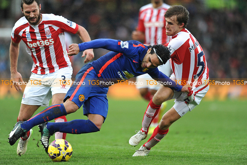Radamel Falcao Garcia of Manchester United battles for the ball with Marc Muniesa & Erik Pieters of Stoke City - Stoke City vs Manchester United - Barclays Premier League Football at the Britannia Stadium, Stoke-on-Trent - 01/01/15 - MANDATORY CREDIT: Greig Bertram/TGSPHOTO - Self billing applies where appropriate - contact@tgsphoto.co.uk - NO UNPAID USE