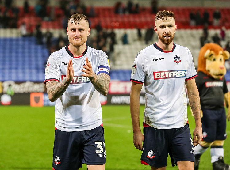 Bolton Wanderers' David Wheater and Mark Beevers applaud the crowd at the end of the match<br /> <br /> Photographer Andrew Kearns/CameraSport<br /> <br /> The EFL Sky Bet Championship - Bolton Wanderers v Rotherham United - Wednesday 26th December 2018 - University of Bolton Stadium - Bolton<br /> <br /> World Copyright © 2018 CameraSport. All rights reserved. 43 Linden Ave. Countesthorpe. Leicester. England. LE8 5PG - Tel: +44 (0) 116 277 4147 - admin@camerasport.com - www.camerasport.com