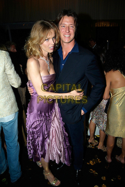 EVA HERZIGOVA & GUEST.Attend Naomi Campbell's Le Carnival D'Or Party, Palm Beach, during the 58th International Cannes Film Festival, Cannes, France, May 19th 2005..full length purple ruffle dress drunk? hugging.Ref: KRA.www.capitalpictures.com.sales@capitalpictures.com.©Persun/Capital Pictures
