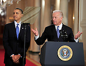 Washington, D.C. - March 23, 2010 -- United States Vice President Joseph Biden makes remarks as U.S. President Barack Obama looks on during the signing ceremony for the version of the health care bill that was passed by the U.S. House of Representatives in the East Room of the White House in Washington, D.C. on Tuesday, March 23, 2010..Credit: Ron Sachs / CNP.(RESTRICTION: NO New York or New Jersey Newspapers or newspapers within a 75 mile radius of New York City)