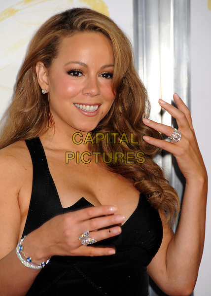 "MARIAH CAREY .2009 AFI Film Festival Premiere of ""Precious"" held at Grauman's Chinese Theatre, Hollywood, California, USA, .1st November 2009..portrait headshot black hands bracelets evil eye diamond silver wedding ring  .CAP/ADM/BP.©Byron Purvis/Admedia/Capital Pictures"