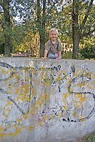 Boy age three having fun climbing on retaining wall. Balucki District Lodz Central Poland