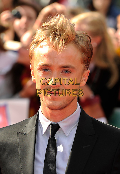 Tom Felton.'Harry Potter and the Deathly Hallows - Part 2' world film premiere arrivals Trafalgar Square, London, England 7th July 2011.HP7 headshot portrait black blue hair sticking standing up.CAP/DH.©David Hitchens/Capital Pictures.