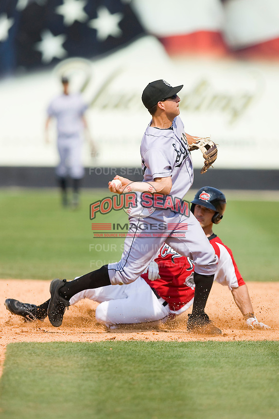 Second baseman Tim Torres #23 of the Jacksonville Suns turns a double play against the Carolina Mudcats at Five County Stadium May 16, 2010, in Zebulon, North Carolina.  Photo by Brian Westerholt /  Seam Images