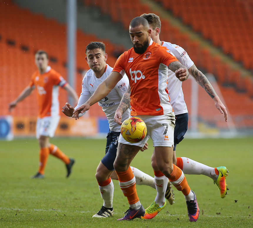 Blackpool's Kyle Vassell battles his way between Luton Town's Glen Rea (right) &amp; Oliver Lee<br /> <br /> Photographer David Shipman/CameraSport<br /> <br /> The EFL Sky Bet League Two - Blackpool v Luton Town - Saturday 17th December 2016 - Bloomfield Road - Blackpool<br /> <br /> World Copyright &copy; 2016 CameraSport. All rights reserved. 43 Linden Ave. Countesthorpe. Leicester. England. LE8 5PG - Tel: +44 (0) 116 277 4147 - admin@camerasport.com - www.camerasport.com