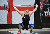 23 FEB 2014 - SMETHWICK, GBR - Emily Godley (GBR / ENG) of Great Britain and England attempts to complete a lift during the women's 63kg category round at the 2014 English Weightlifting Championships at the Harry Mitchell Leisure Centre in Smethwick, Great Britain. Godley's total of 191kg makes her eligible for selection for the England team for the 2014 Commonwealth Games (PHOTO COPYRIGHT © 2014 NIGEL FARROW, ALL RIGHTS RESERVED)