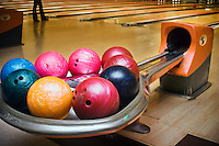 "Bowling balls ready to be used at ""Lanes and Games."""