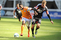 Warren Creavalle (5) of the Houston Dynamo goes against Conor Doyle (30) of D.C. United. The Houston Dynamo defeated D.C. United 2-1, at RFK Stadium, Saturday October 27, 2013.