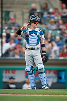 Charlotte Knights Zack Collins (8) signals one out during an International League game against the Rochester Red Wings on June 16, 2019 at Frontier Field in Rochester, New York.  Rochester defeated Charlotte 3-2 in the second game of a doubleheader.  (Mike Janes/Four Seam Images)