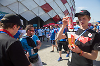 MOSCOW, RUSSIA - June 16, 2018: A vendor pours a beer for fans gathered outside Spartak stadium before the Iceland vs. Argentina game at the 2018 FIFA World Cup.