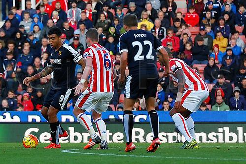 24.10.2015. Britannia Stadium, Stoke, England. Barclays Premier League. Stoke versus Watford. Troy Deeney of Watford is watched by Glenn Whelan of Stoke City