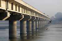 A large bridge passes over the Ganges River in Kanpur. This stretch of the river is now regarded as the most polluted stretch of its entire length, as a result of the local leather tannery industry which dumps its water waste directly into the river.